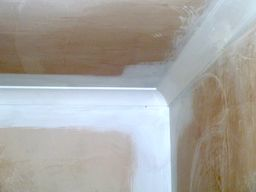 cutting in at edges and ensuring coving is not a vapour path